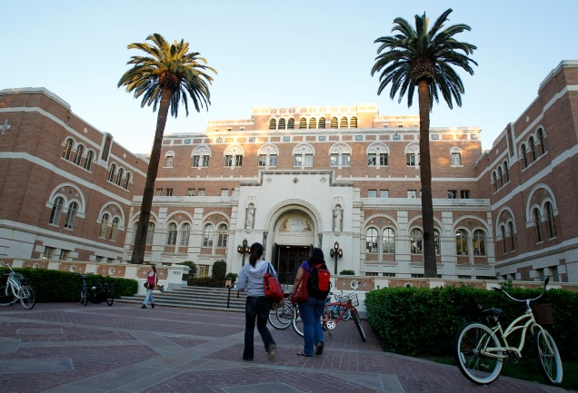Students walk by Doheny Memorial Library at the USC in Los Angeles